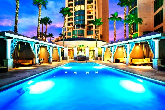 Park Towers luxury high-rise condo's pool at night with cabanas