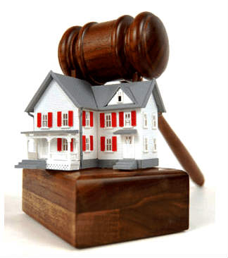 A house under a gavel representing Las Vegas real estate auctions